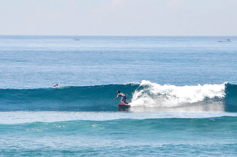 Surfer à Berawa, Batu Bolong ou Echo Beach